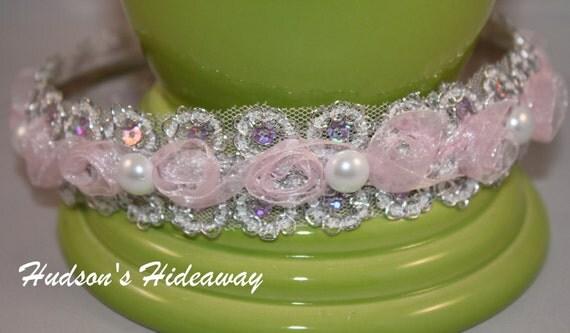 Pink chiffon, pearls and glitz make this stunning headband