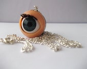 Blinking doll's eye long silver necklace - bright blue eyes and fluttering eyelash detail
