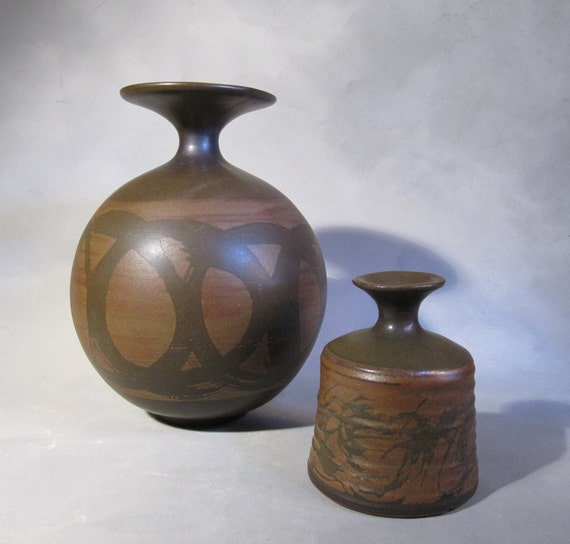 Stoneware Designs West, Pair of vases, stickered and signed