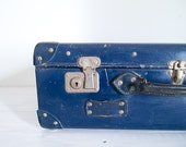 navy blue vintage suitcase with leather handle