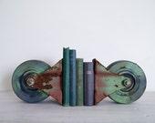 reserved for sarah - vintage industrial green castor set/bookends