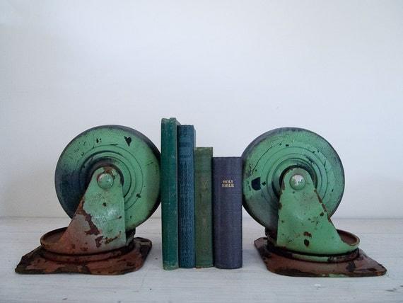 reserved for vivienne - vintage industrial green castor set/bookends