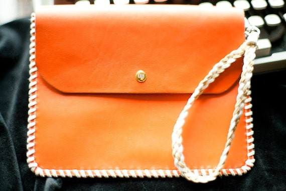 Leather Clutch in Orange, hand laced. Custom button and embossing.