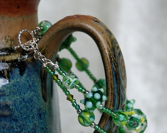 "Sterling Silver, Swarovski Crystal,Lime Green Lamp Work, Glass, and Seed Bead, Beaded Double Strand Toggle Clasp ""Lime Gummi Fruit"" Bracelet"