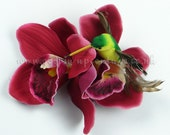 Burgundy Orchids with Hummingbird