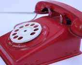 Vintage red tin toy telephone, phone