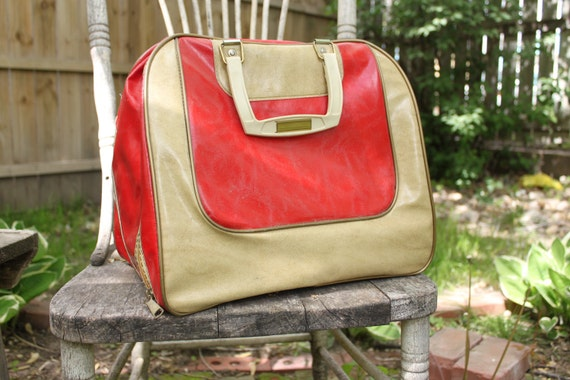Vintage, retro red and cream carry on bag, camera bag, make up bag, bolwing bag
