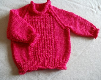 Bright pink chunky knit girls roll edged sweater to fit 12 - 18 months