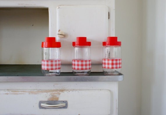 vintage french glass jars for storing foodstuff, made by Felix Potin in red and white checkered print