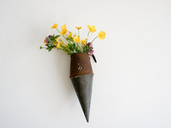 rustic french hanging vase, originally used by french farmers to carry their whetting stones to sharpen their scythes