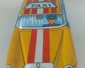 Antique Tin toy car Taxi marked made in Japan tin litho