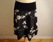 knee lenght skirt, white floral embroidery on black satin