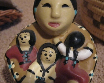 Beautiful Candle depicting a Native American Mother (or Grandmother) with Her Children