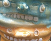Stacked Toothy Face, Green & Orange Wobble Tumbler