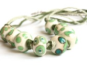 Emerald grass green ivory lampwork glass beaded necklace with linen cord, OOAK
