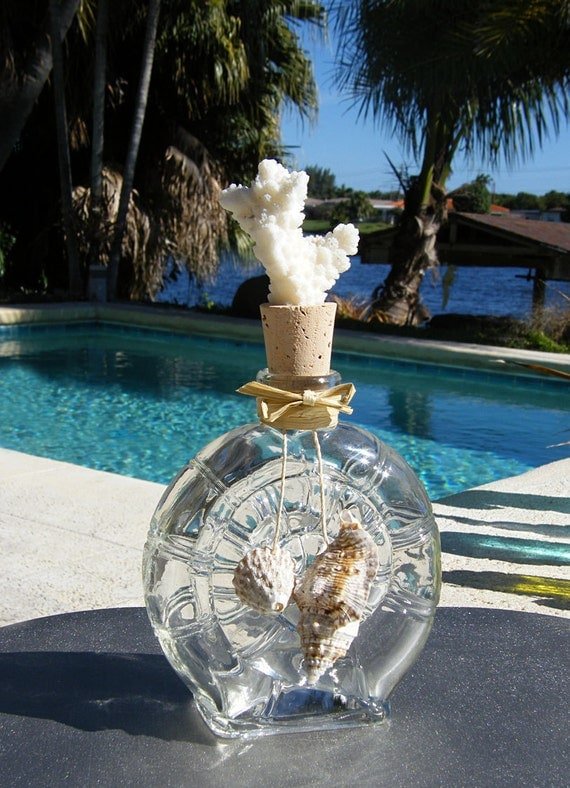 Shell shaped glass bottle adorned with coral and seashells. Fill with perfumes, lotions, salts, or essential oils. Great gift.