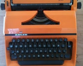 Reserverd for Matthew - Laptop typewriter Adler Junior made in Holland from the 70s (orange)