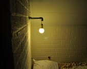 Reserved for bilot - Wall lamp made out of pipes