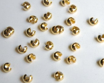 50 Crimp bead covers gold plated 4mm DB03074