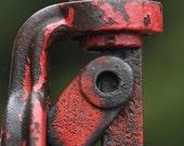 Vintage hand water pump.  Red enamel, rust, green, abstract, metal