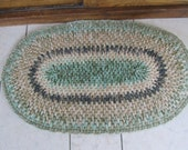 Rag rug tan with shades of green all wool from recycled sweaters