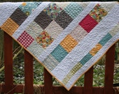 Colourful handmade baby quilt / contemporary lap quilt / patchwork quilt