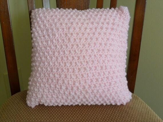 Soft, pink crocheted pillow