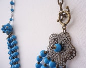 Beaded necklace in blue and antique tones