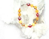 Evil Eye  bracelet yellow and red