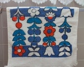 Retro terry cloth towel with blue and red floral print