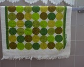 Retro terry cloth towel with green yellow and brown circles