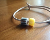 african trade bead, yellow bead and leather bracelet with sliding knots for boys or girls
