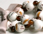 Bracelet with ceramic painted beads, glass and wood beads and satin ribbon