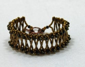 Beaded Bracelet Swarovski Crystals, Bugle Beads, Seed Beads in Bronze by JKAlvarez. Item 2022BR.
