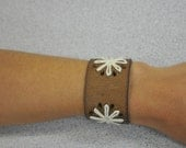 Brown leather with cream threaded flowers cuff