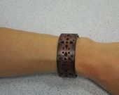 Dark brown leather with cut-out stars cuff bracelet