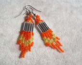 Petite seed bead beaded earrings in orange, gold and green.