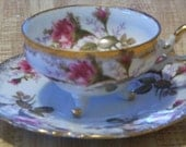 Vintage Napco Three Footed Cup and Saucer with Rose Pattern