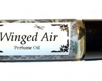 WINGED AIR - Roll on Premium Perfume Oil -2 sizes to choose from - 1/3 oz or 1/6 oz - a flirty colorful blend with a hint of fresh greenery.