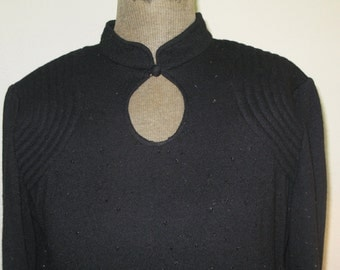 French Import: Elegant Black knit dress. Trupunta stitching on shoulders with jet black beads woven in.