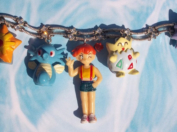 Misty and Her Pokemon Charm Bracelet with Horsea, Goldeen, Staryu, Starmie, Psyduck, Togepi, and Misty