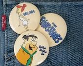 trio of Flintstones pinback buttons