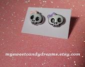 pink and purple skull earrings