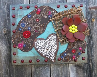 Recycled wall art using fabric, metal and other found objects