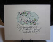 Adorable 1920's-30's unused congratulations greeting card for a new baby baby in basket made by Davis