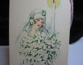 1920's Art Deco Die bridge tally wedding theme flapper bride with beautiful bouquet and candle gibson