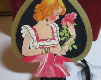 Vintage 1930's die cut bridge tally card in shape of  card suit spade pretty girl holding rose wearing silhouette brooch