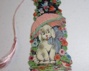 1920's-1930's Die cut bridge tally P F Volland dog under umbrella in a colorful garden with birds