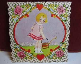 Cute 1930's die cut embossed gold gilded carrington valentine bobbed hair girl with watering can pink roses