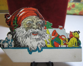 Vintage 1920's-30's  colorful die cut christmas place card santa claus and toys unused rust craft